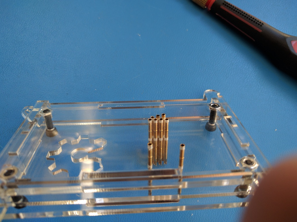 Slightly push out pogo pins you want to connect with PCB first. In this case GND then VCC.